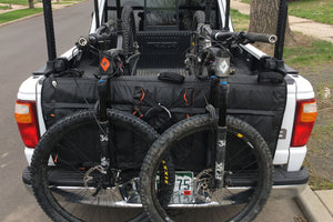 Bicycles, tools, beers, even a shower — RMU's first tailgate pad packs more functions than mountain bikers will expect.
