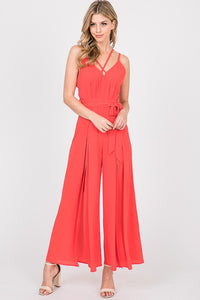 Versatile Charms in a Jumpsuit in Black and Tomato Red