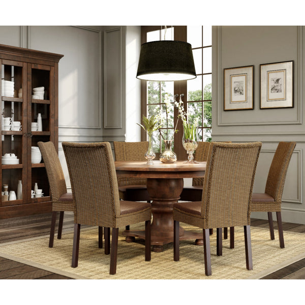 Filomena round dining table with 6 ibiza chairs on a dining room.