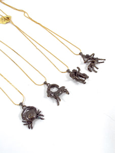 Vintage 70s Faux Gold and Bronze Zodiac Charm Necklace - Cancer, Capricorn, Gemini, Sagittarius
