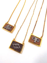 Load image into Gallery viewer, Vintage 70s Faux Gold and Wood Zodiac Charm Necklace - Aquarius, Pisces, Aries