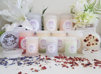 Scented candles handmade with soy wax in frosted glasses