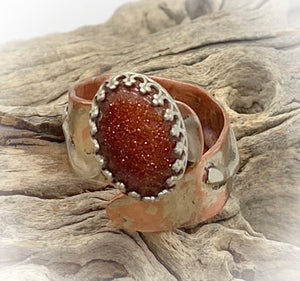 copper and silver goldstone ring