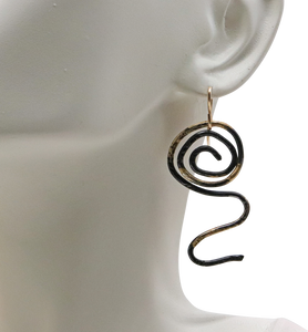 "Sacred Spiral Steel and 18K gold Earring. 1 7/8"" long"