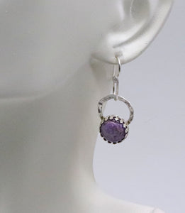 charoite earrings on ear