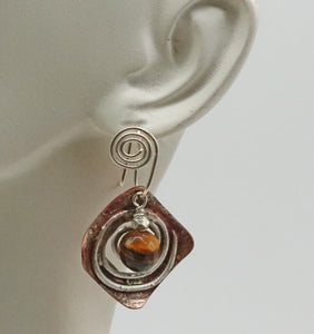 tigers eye earring shown on ear