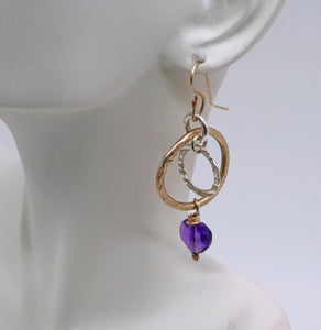 amethyst gold earrings shown on ear lobe