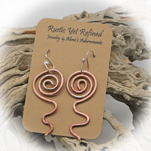 sacred spiral earrings shown on card