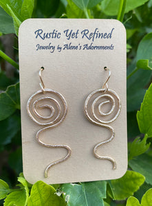 sacred spiral earrings in gold