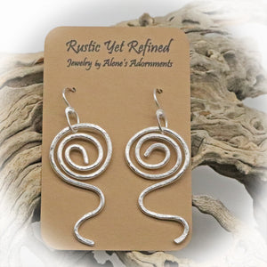 sacred spiral earrings shown on romance card