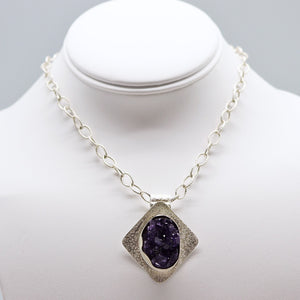 purple gemstone jewelry. purple amethyst geode
