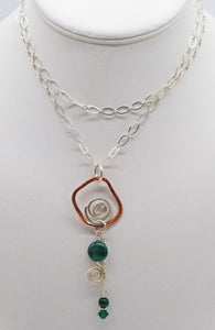handmade in Arizona copper and sterling pendant with malachite gemstone