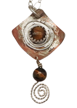 Load image into Gallery viewer, closeup of tigers eye pendant spiral design