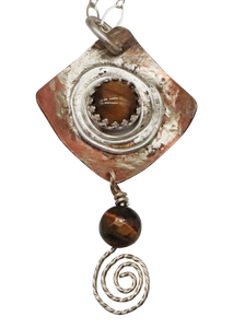 closeup of tigers eye pendant spiral design