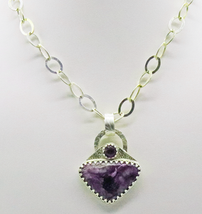 silver pendant with charoite gem