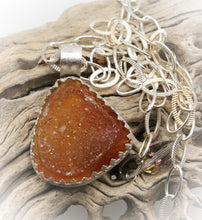 Load image into Gallery viewer, druzy pendant shown in nature
