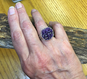 view on a hand of the handmade amethyst geode ring