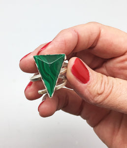 showing off the size of the malachite super sized gemstone ring