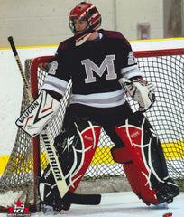 Ice Hockey Goalie watching the play to his right, standing up in position.