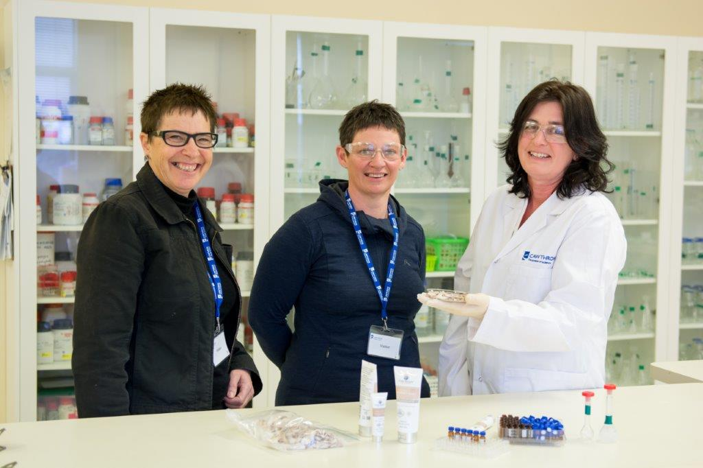 Pure peony founders scientifically testing dove river products in a lab