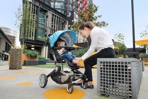 Coast stroller. Blue stroller. 4-wheeled stroller. use from birth stroller. Image: mother chats with her child in the coast stroller in blue
