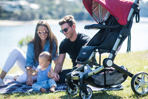 Coast stroller. Outdoor stroller. Lightweight and compact stroller. Image: Larktale family sits outside with the coast stroller