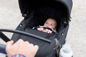 Coast stroller. baby carry cot. baby bassinet. coast travel system. Image: baby rests in the coast stroller using a carry cot