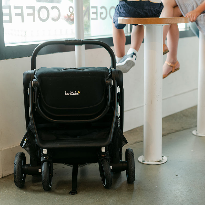 autofold stroller folded up while kids eat ice cream