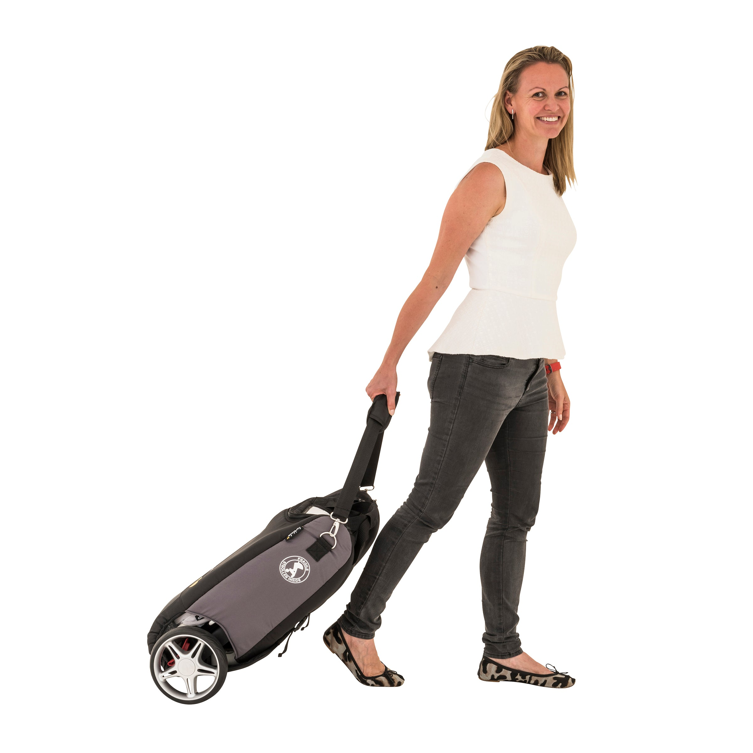 travel bag. stroller travel. stroller carry bag. travel with your stroller. woman wheels the chit chat stroller in the travel bag along like luggage