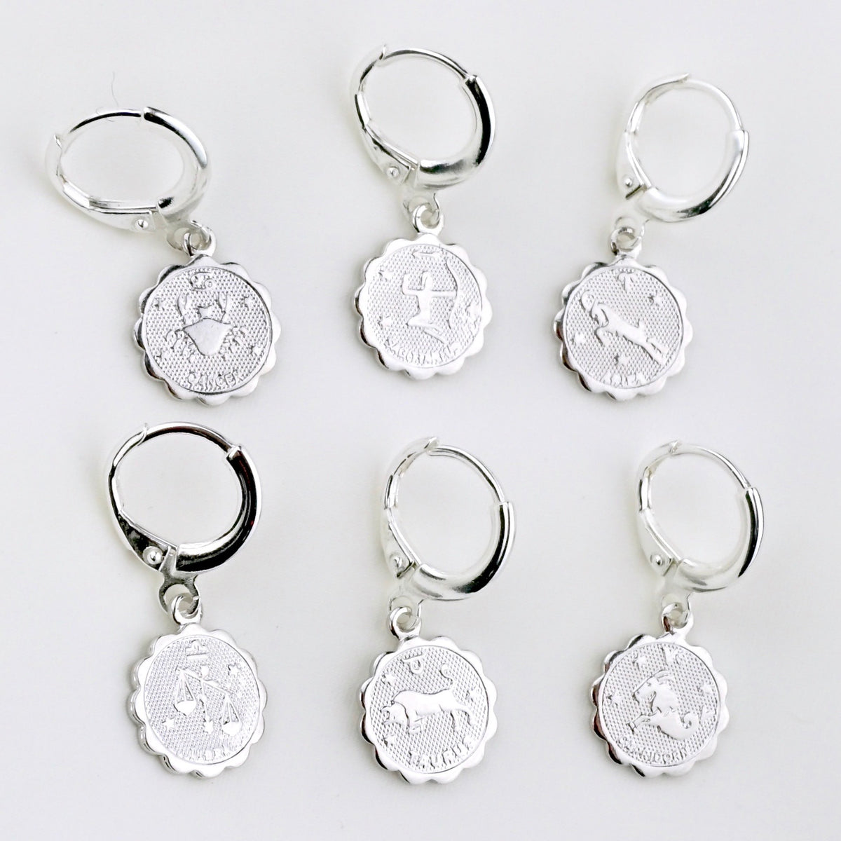 Silver Star Sign Coin Earring