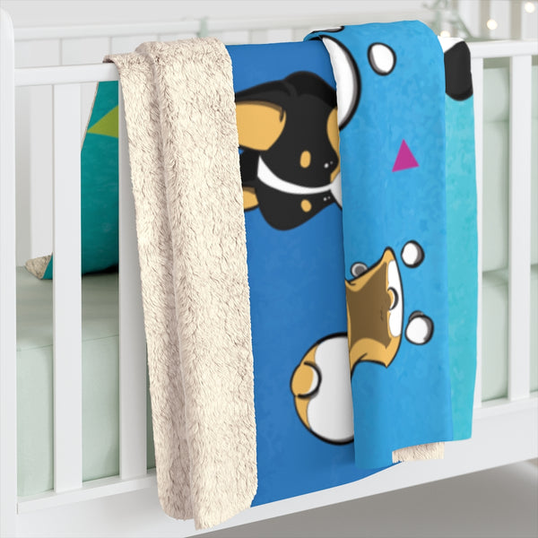 corgi sherpa blanket folded and placed over the side of a crib.