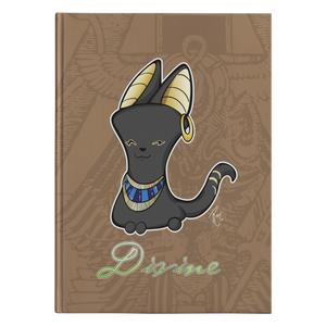 "Product image of Bast journal. Brown, Egyptian art background, black Egyptian god cat character, ""Divine"" written underneath in green gradient."