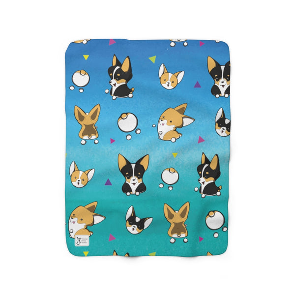 corgi pattern blanket (small). marshmallow red and white corgis and tri-color corgis, triangles in between on a blue and aqua background.