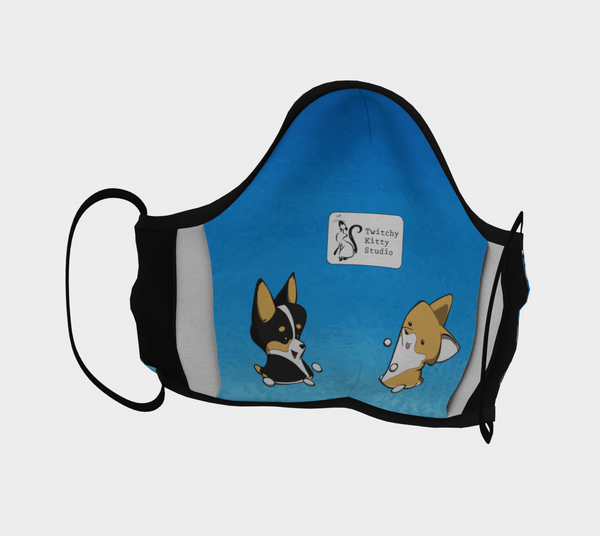 interior of corgi pattern mask. Filter pocket features blue background, logo in middle, and two marshmallow corgi puppies on bottom