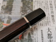 Ebony and black buffalo handle with nickel trim