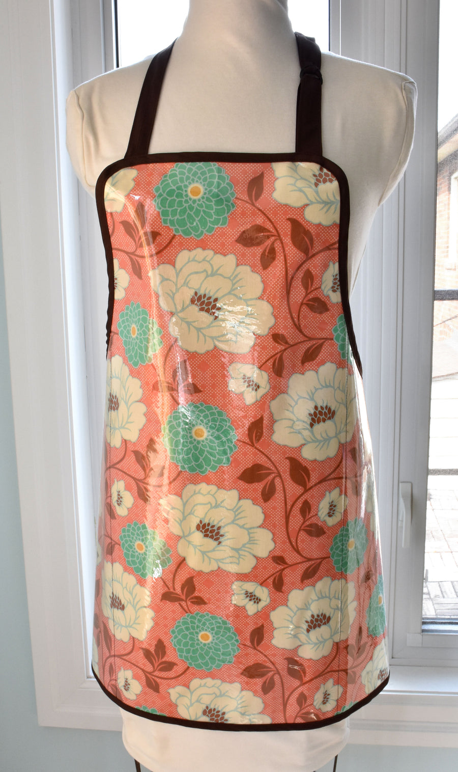 Waterproof full apron in coral dahlia floral print cotton with vinyl covering