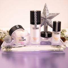 SeeMe Beauty Dynamic Duo and travel size Duo with shiny holiday ornaments