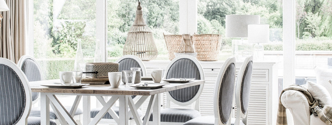 french country style white wooden furniture in dining and living room