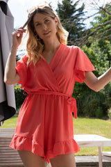 Playsuit with belt in Coral