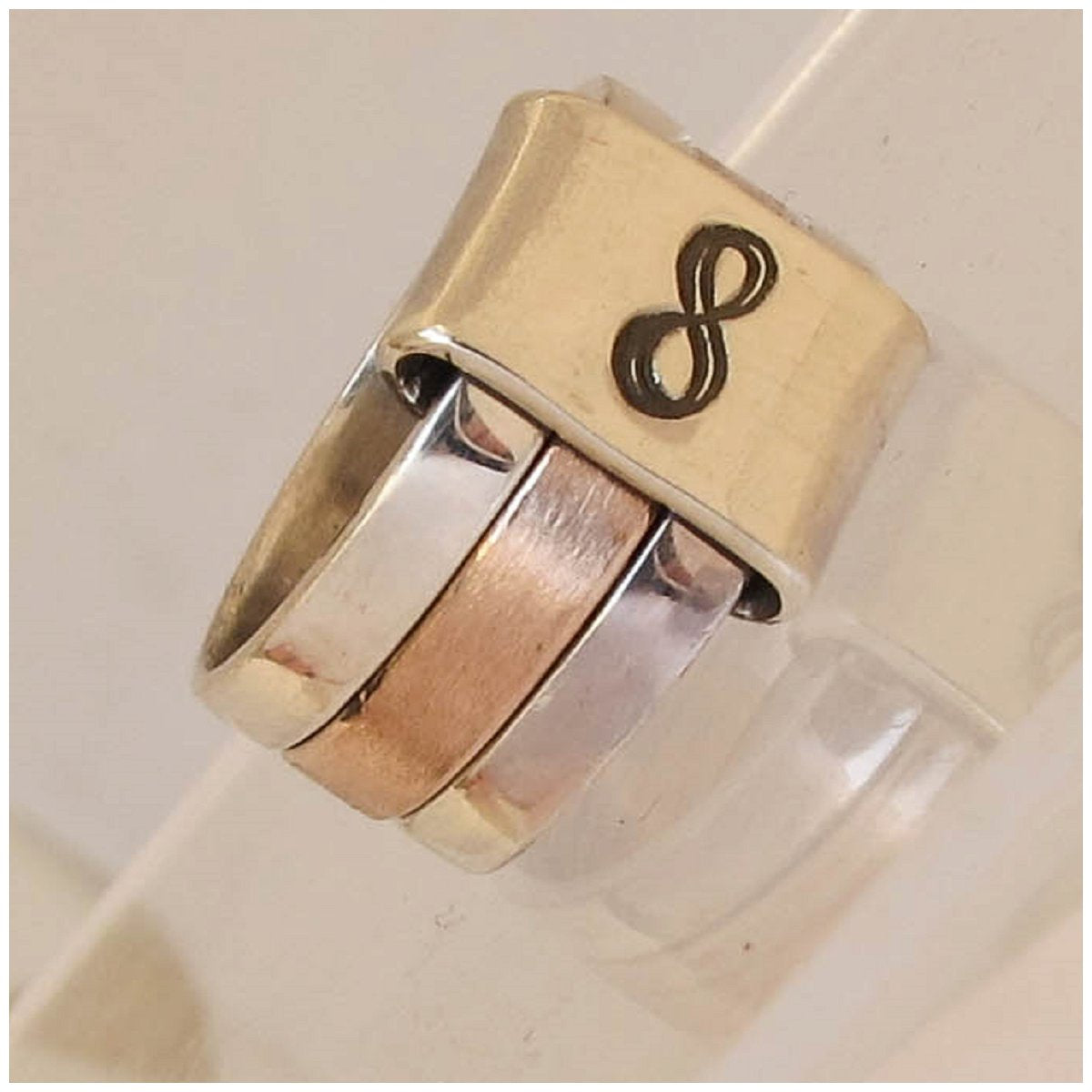Sterling silver and 9ct rose gold infinity ring