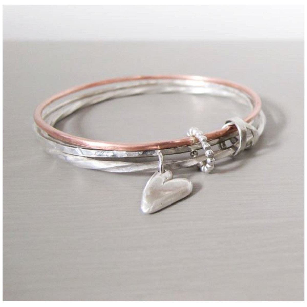 Rose gold and silver triple bangle
