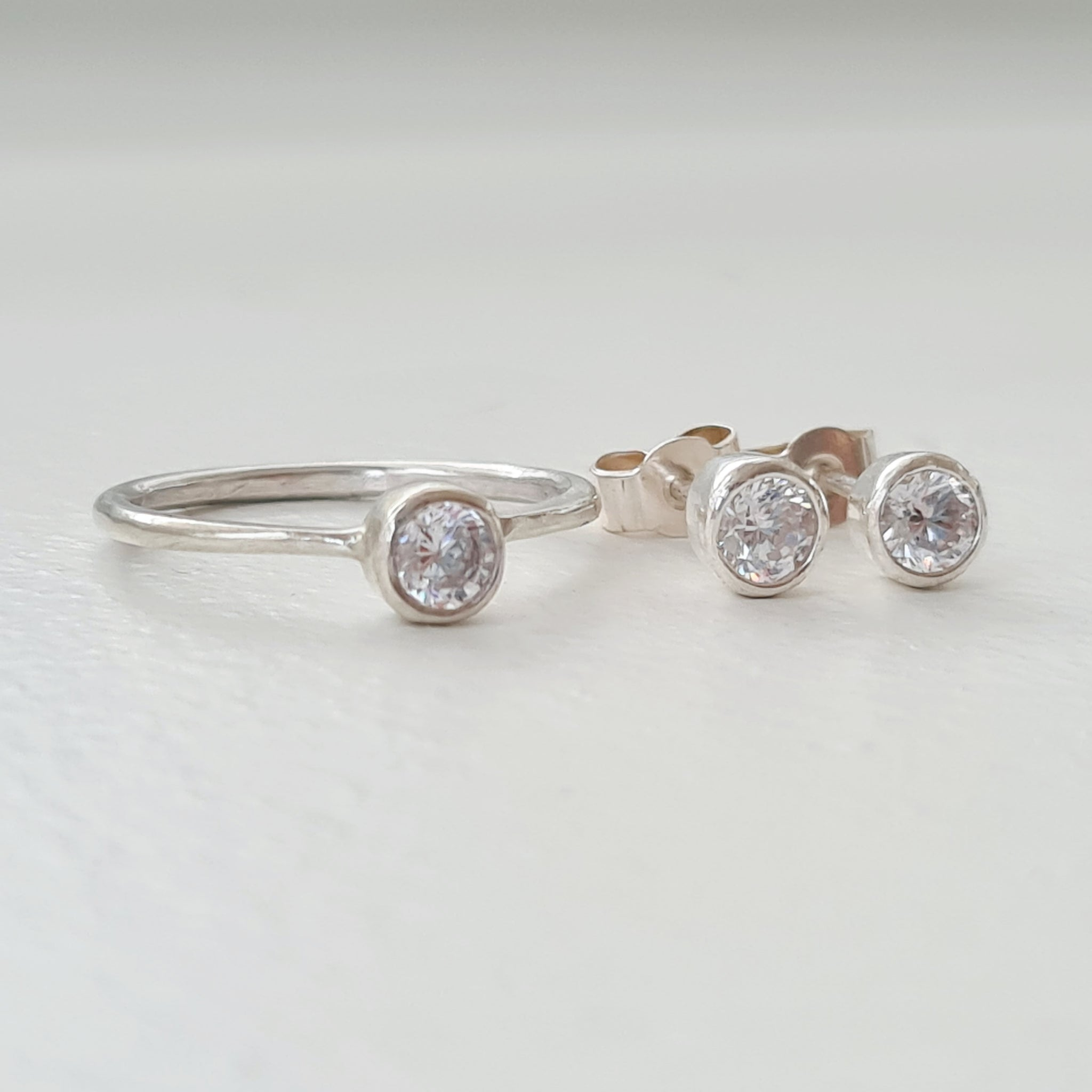 Earring and matching ring solitaire set