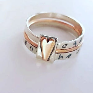 Sterling silver and 9ct rose gold spinner heart ring
