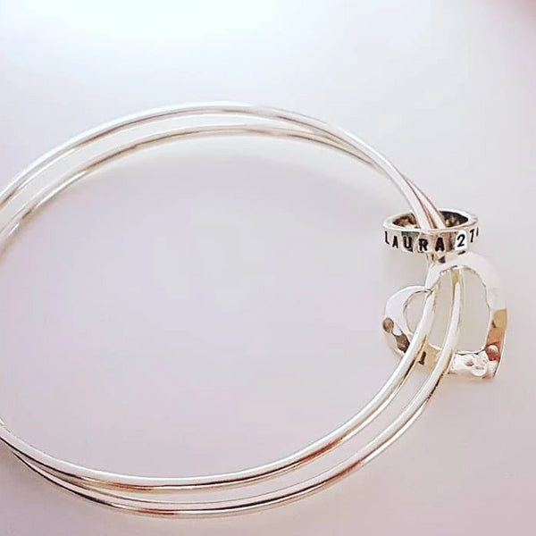 Silver double bangle with name ring and heart charm