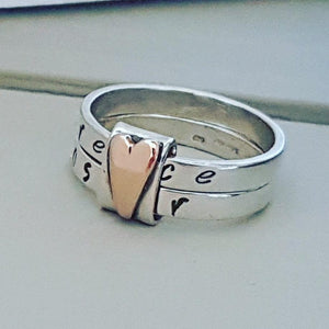 Sterling silver rings with spinner heart