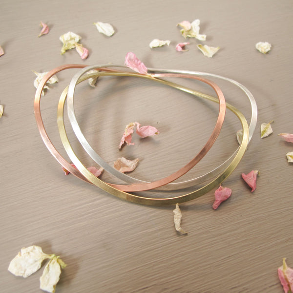 sterling silver, rose gold and yellow gold wave bangle