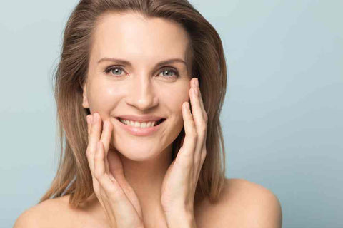 woman using collagen for the promotion of healthy skin and other benefits