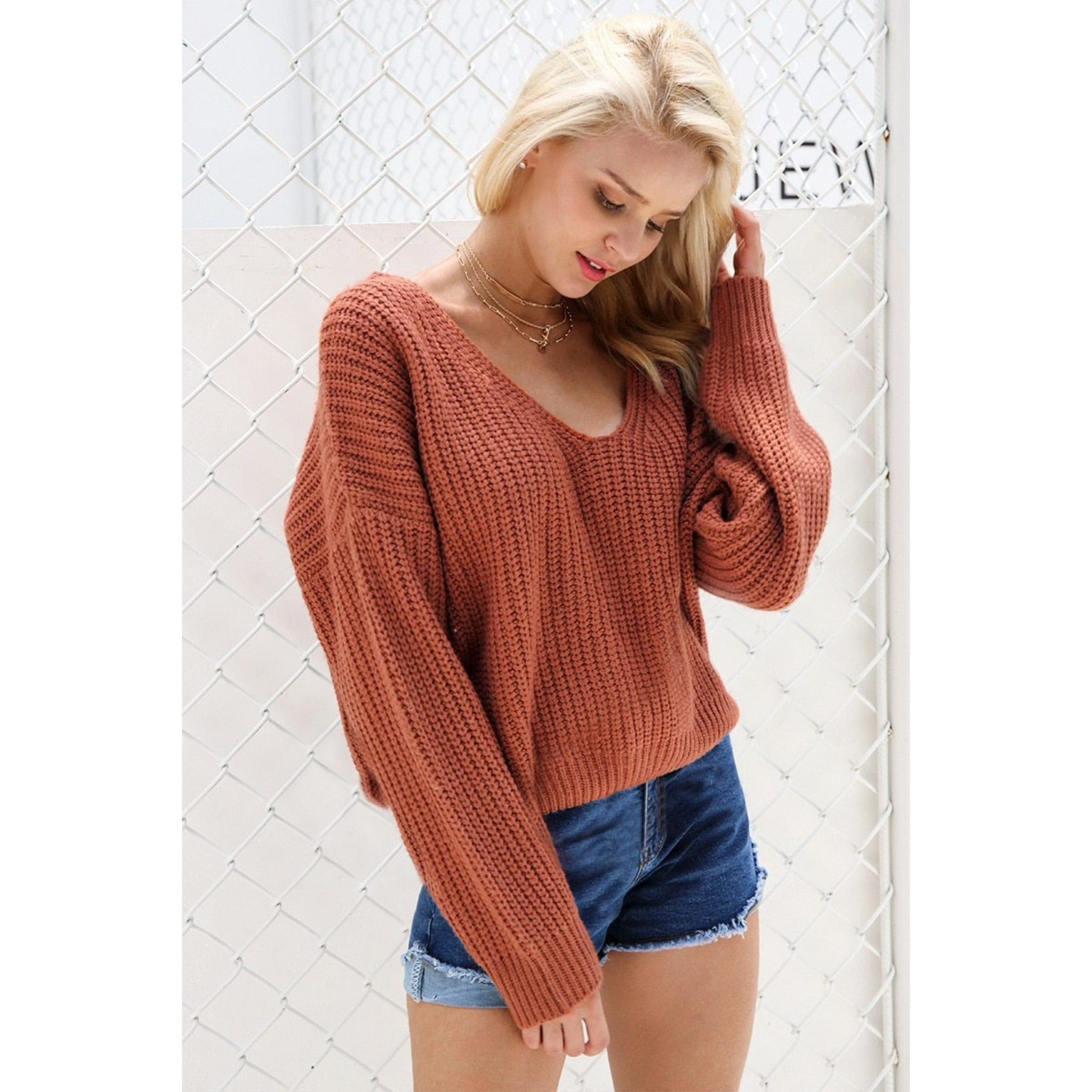 Women's Fall Sweater Outfit with an Open Back Sweatshirt that Laces up the back Knitted sweater and long sleeves