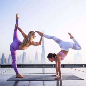 White Mesh Leggings Cutouts and Purple Mesh Cutout Leggings in a yoga Pose
