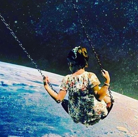 Girl on swing in universe